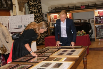 Lauren Chandler and James Fouracre looking at their House photos in the Old Chapel